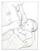 Baby preparing to latch on to nipple