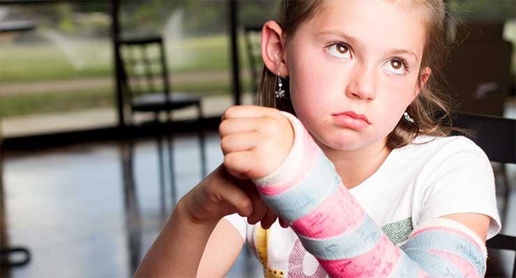 Sad girl with a cast